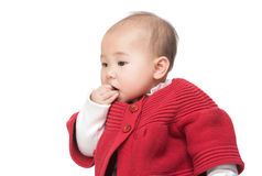 Asian baby girl suck finger Royalty Free Stock Image