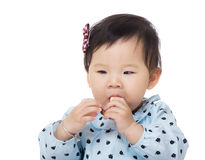 Asian baby girl suck toy block into mouth Royalty Free Stock Photo