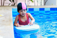 Asian baby girl in swimming pool Royalty Free Stock Images