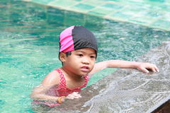 Asian baby girl in swimming pool Stock Photography