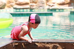 Asian baby girl in swimming pool Royalty Free Stock Image