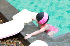 Asian baby girl in swimming pool Royalty Free Stock Photography