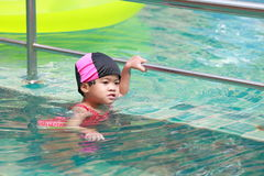 Asian baby girl in swimming pool Stock Photos