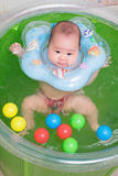 Asian baby girl swimming Stock Images