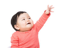 Asian baby girl touch top Stock Photo