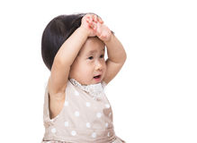 Asian baby girl touching her head Stock Photography