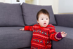 Asian baby girl try to stand Stock Photography
