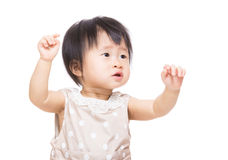 Asian baby girl two hands up Royalty Free Stock Photography