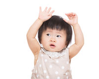 Asian baby girl two hands up Royalty Free Stock Image