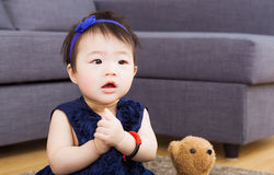 Asian baby girl wishing at home Royalty Free Stock Photo
