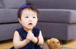 Asian baby girl wishing at home Royalty Free Stock Photo