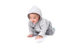 Asian baby in gray jacket with a hood, isolated on white backgro Stock Photo