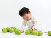 Asian baby with green apples Royalty Free Stock Images