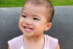 Asian baby grinning,making a face Stock Photography