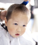 Asian baby haircutting Royalty Free Stock Photo