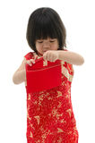 Asian baby holding ang pow or red packet monetary gift Royalty Free Stock Images