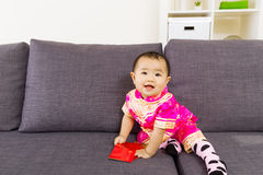 Asian baby holding red pocket with traditional chinese clothing Stock Photo
