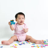 Asian baby holding toy car Royalty Free Stock Photos