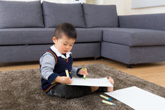 Asian baby kid drawing. At home Stock Image