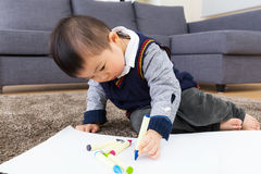 Asian baby kid drawing. At home stock images