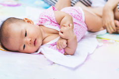 Asian baby lie prone on ground at park Royalty Free Stock Photos