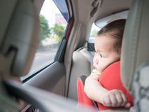 Asian baby look out while sit in car. Stock Photos