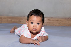 asian baby lying on bed Royalty Free Stock Photo