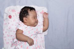 Asian baby lying on bed Royalty Free Stock Photography