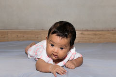 Asian baby lying on bed Royalty Free Stock Photos