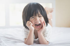 Asian baby lying on the bed Stock Photography