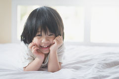 Asian baby lying on the bed Royalty Free Stock Photo