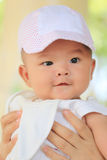 Asian baby in a mom hand and smile with happily. Royalty Free Stock Image