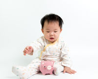 Asian baby with piggy bank Stock Images