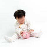 Asian baby with piggy bank. Portrait of Asian baby with piggy bank Stock Images