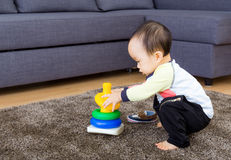 Asian baby playing pyramid build Stock Images