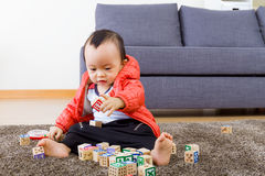 Asian baby playing wooden block Stock Images