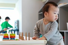 Asian baby playing with wooden blocks. Aisan baby playing with colorful wooden blocks stock photos