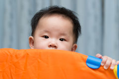 Asian baby in playpen Stock Images