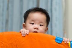 Asian baby in playpen Stock Image