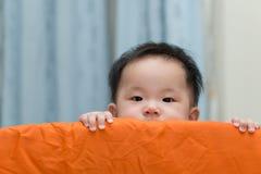 Asian baby in playpen Stock Photo