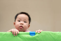 Asian baby in playpen Royalty Free Stock Photography