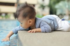 Asian baby by pool Stock Photography