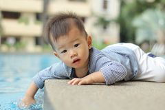 Asian baby by pool Stock Photo