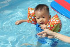 Asian baby in pool Royalty Free Stock Photo