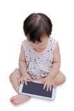 Asian baby is sitting and playing with tablet pc Stock Photos