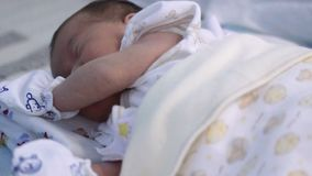 Baby sleeping face. Close up of a four-month old baby resting and squirming. stock video footage