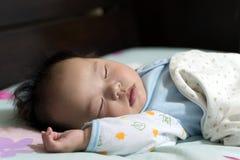 Asian baby sleeping Royalty Free Stock Photos
