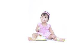 Asian baby smear birthday cake on white background stock photography