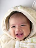 Asian baby smile with head leaning. Isolated bare headed royalty free stock image