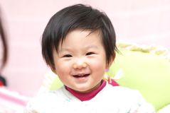 Asian baby smiling Royalty Free Stock Photo